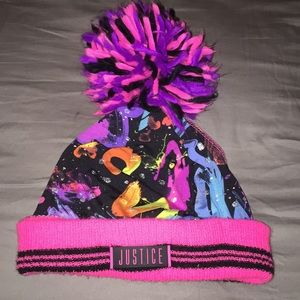 Justice winter tassel hat with pony tail slot.